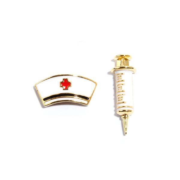 Medical White Stud Earrings by Pigeonhole. http://aslanandleo.com/product/medical-white-stud-earrings-by-pigeonhole/