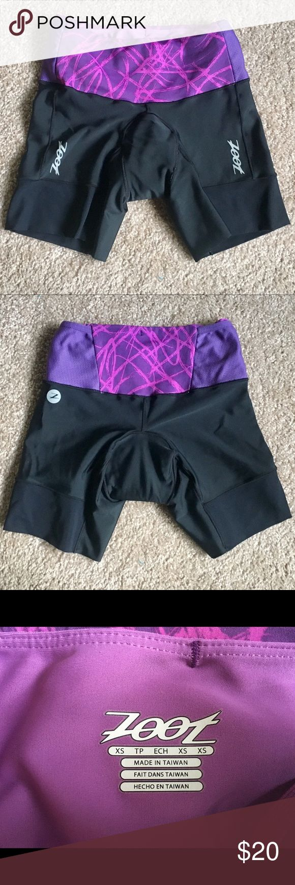 """Black/Purple Zoot Active Tri Shorts XS Zoot Active Tri Shorts, size XS. Triathlon Shorts with thin chamois pad that is quick drying after swimming. Black shorts with purple waistband. Waistband has internal drawstring. 6"""" inseam. I am 5'3"""" and ~105lb for reference. These run small, they are tight on me, but not uncomfortably so. I do prefer the size S though. Only worn a handful of times, still in great condition! See my triathlon top for bundling option :) Zoot Shorts"""