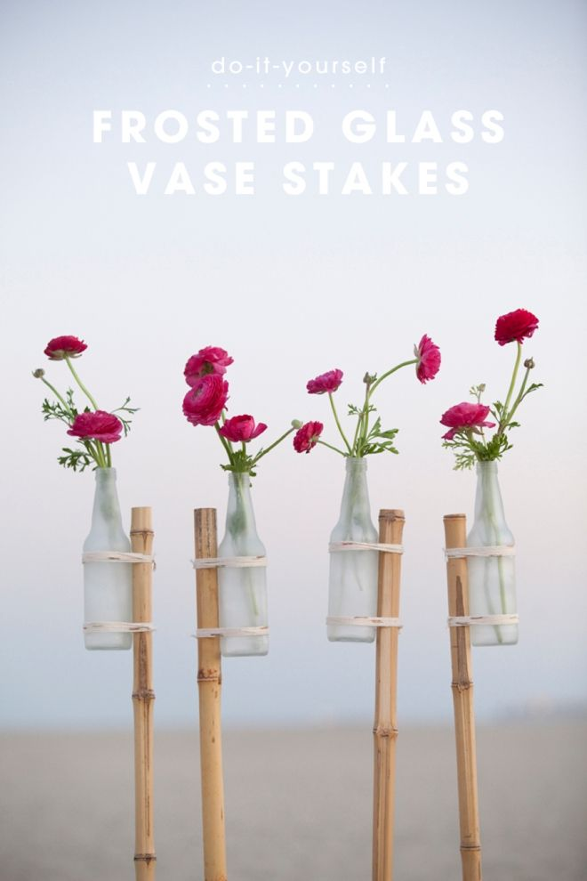 The absolute perfect detail for your outdoor wedding or event, these gorgeous DIY bamboo stakes have glass vases tied to them to  display flowers !