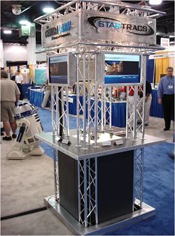 From The Source Electronics to Wall Mart and Costco, VersaTruss Plus has provided custom and modular aluminum truss kiosks for every kind of display  kiosks with curved truss imaginable. We have housed cell phones and books to bank machines and more. We have been honored by creating kiosks for museums and book releases.  Some of our Kiosks have been used as permanent structures at Golf courses for food confectionaries, bars, pro shops and entrance ticket booths.