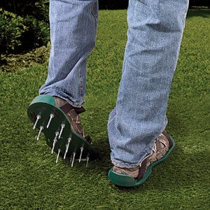 "Lawn Aerator Sandals   $14.98    Product #AP5340 - Keeping your lawn properly aerated is an important way to keep the grass healthy and growing strong. Wear these lawn aerator sandals right over your shoes when you mow, taking care of two things at once. Made of durable high-grade plastic with 13 metal spikes per sandal. Measures: 12"" x 5-1/4"" Spikes: 2"""