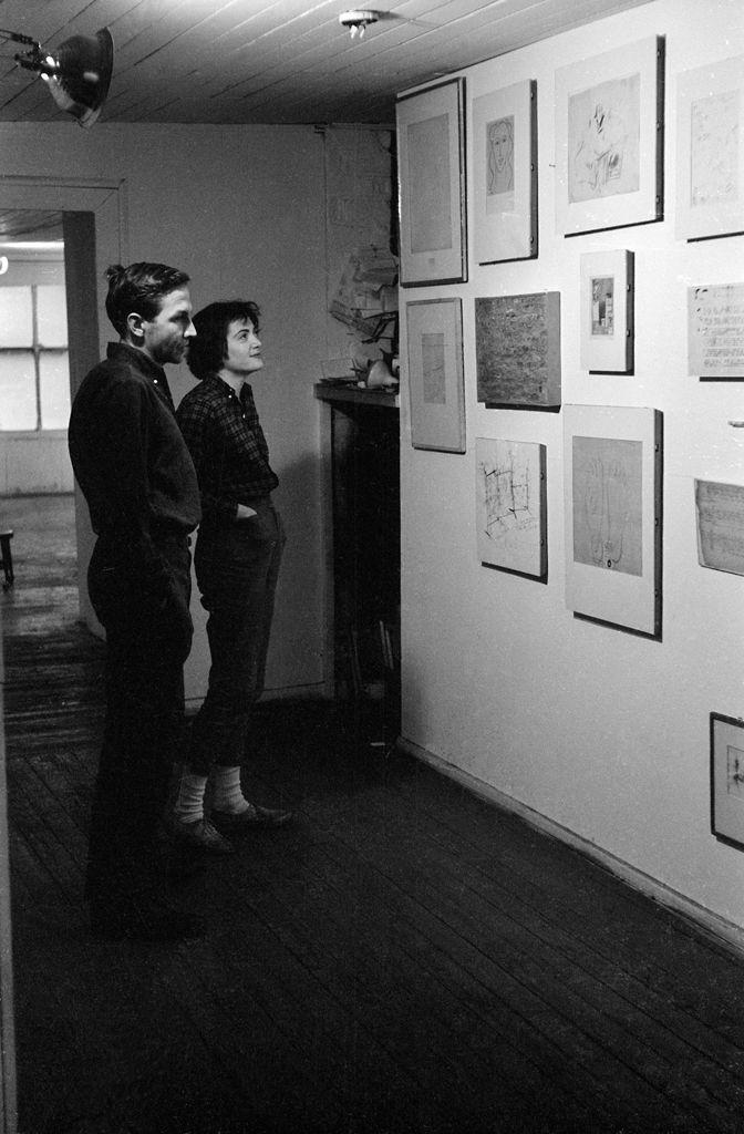 Robert Rauschenberg at his Front Street studio with Erased de Kooning Drawing (1953). SFMOMA