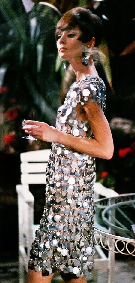 Audrey Hepburn photographed by Terry O'Neill during the filming of Two for the Road in Grimaud, Var, France, August 1966. Audrey is wearing silver paillette dress by Paco Rabanne