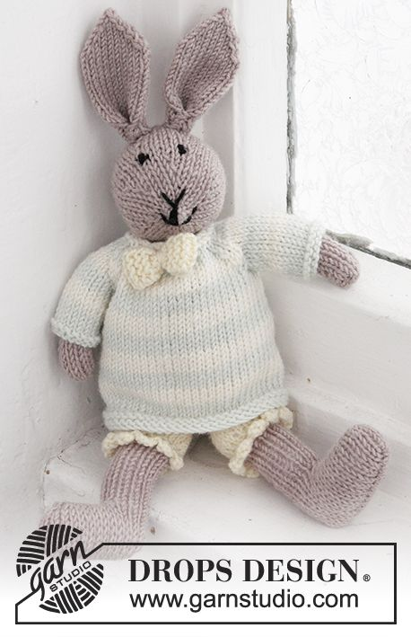 "Mr. Bunny - Knitted DROPS bunny with pants, jumper and bow in ""Baby Merino"". - Free pattern by DROPS Design"