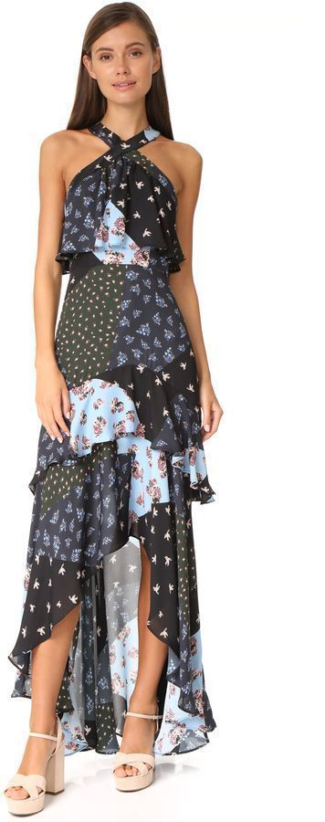 Parker Filippa Combo Dress This patchwork Parker dress has a mixed pattern of flowers and birds. The high-low skirt falls lower in back, and draped ruffles create soft movement. Hidden back zip. Lined.