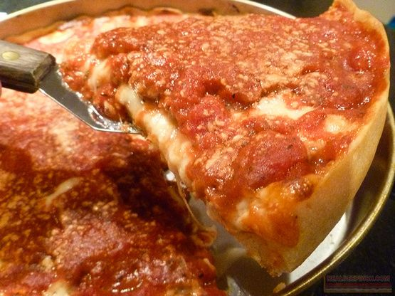 This recipe comes from the book Pizza and is just wonderful. It can be hard to press the pizza up the sides of the pan, but just let the dough rest for a bit first and it should be easier.