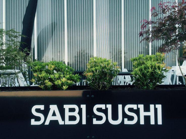 Stunning gloss black steel planters at Sabi Sushi in Norway.