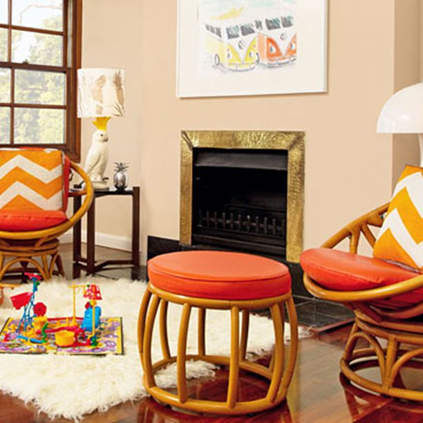 Peachy walls are perfect when paired with gold and bold orange to give your home that summer glow