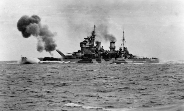 "HMS Anson, a type ""King George V"" battleship, shoots her 356-mm main guns BL-Mk VII during trials in the North Sea, 1942. Note the northern waters camouflage paint."