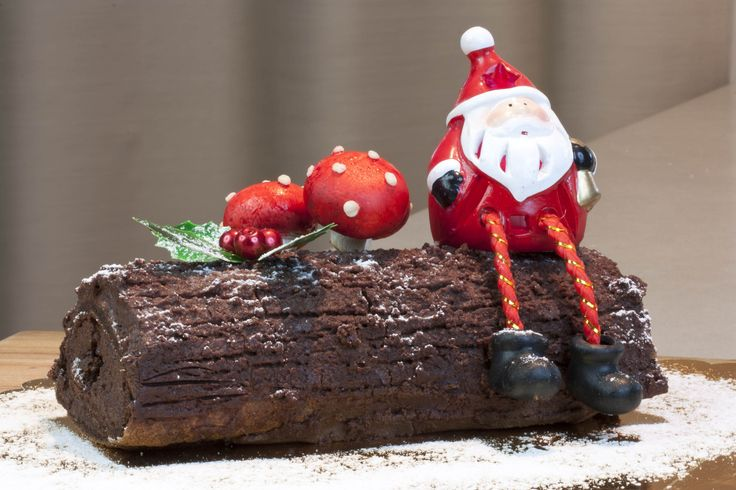 Buche Noel. A flourless French Christmas log, with lots of chocolate cream. It is not easy to make and took me three tries at getting it somewhat right. It is a Lebanese favourite from the French influence way back. The mushrooms are actual mushrooms painted with food colouring.