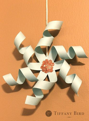 With only a few pieces of paper, decorate your home with these twirly paper snowflakes from Simply Modern Mom. The unique spin gives the snowflakes a 3D feel that looks great when hung from the ceiling. Create many for a paper snowstorm!