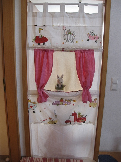 Handmade doorway puppet theater! Use a curtain to make it easy!