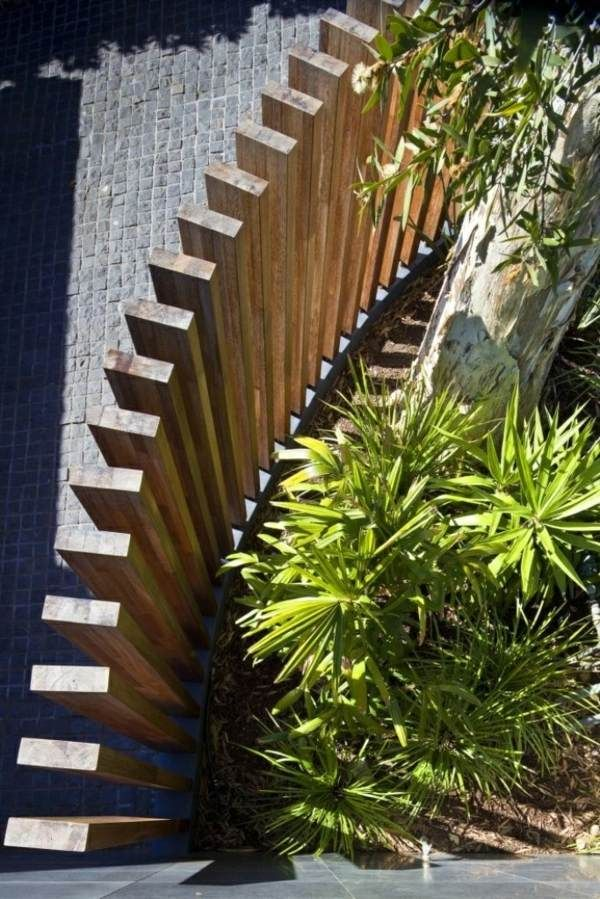 Wooden privacy fence modern design idea. Could be wood or could be steel?