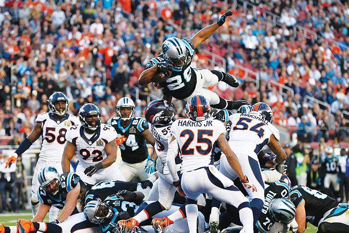 Carolina Panthers' Jonathan Stewart (28) skies for a 1-yard score vs. Denver in Super Bowl 50.