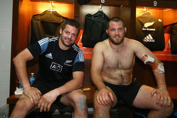 Owen Franks Photos Photos - All Blacks captain Richie McCaw and Owen Franks of the All Blacks relax in the All Blacks changeroom after winning The Rugby Championship match between Argentina and the New Zealand All Blacks and claiming the Rugby Championship title at Estadio Ciudad de La Plata on September 27, 2014 in Buenos Aires, Argentina. - Argentina v New Zealand - The Rugby Championship