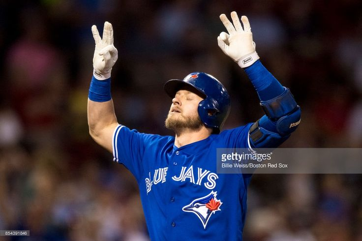 Josh Donaldson #20 of the Toronto Blue Jays reacts after hitting a solo home run during the first inning of a game against the Boston Red Sox on September 26, 2017 at Fenway Park in Boston, Massachusetts.