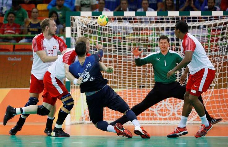 Luka Karabatic of France tries to shoot against Denmark in the gold medal Handball match during the Rio 2016 Summer Olympic Games at Future Arena.  Andrew P. Scott, USA TODAY Sports