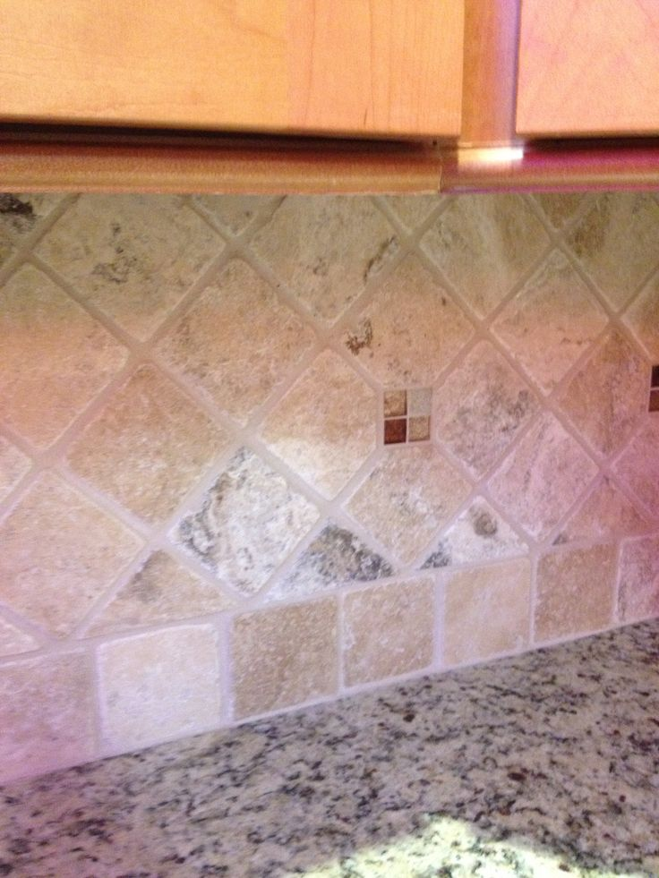 Tumbled marble backsplash with mosaic glass piece accents for Tumbled glass tile