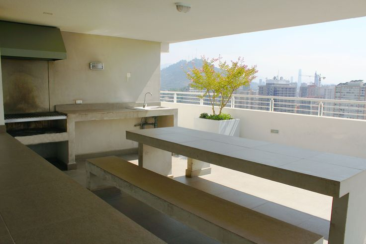 on the roof there is some place to do barbecue and invite some people to sit down. A nice barbecue with a nice view on the roof of the building of the apartment we rent in Santiago de Chile www.internshipandtravel.cl o mail a info@internshipandtravel.cl