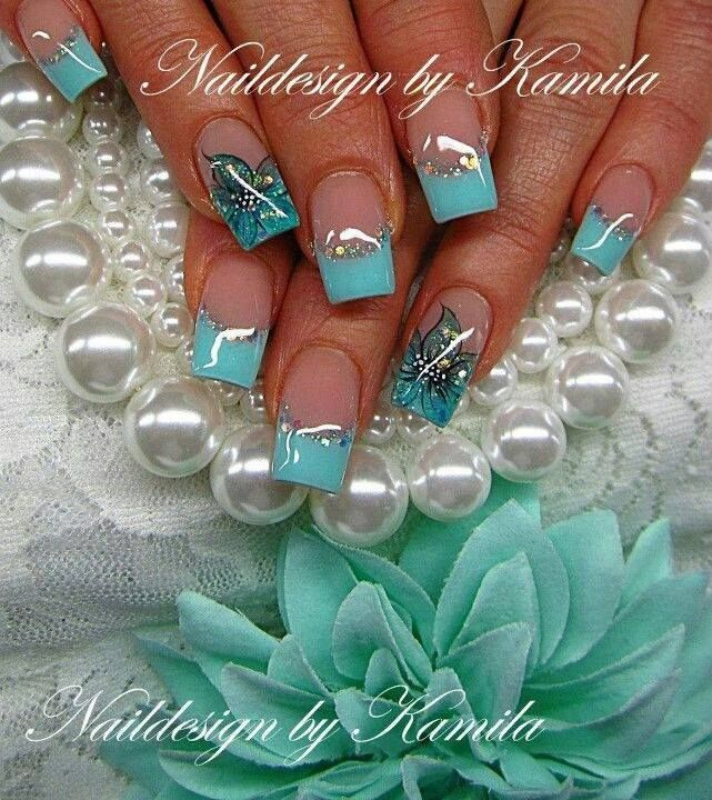 Glittering Blue French Nail Design With Floral Accent