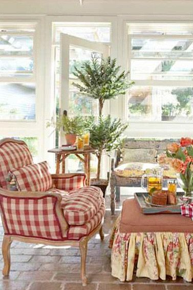 Living room with red and white check/gingham/buffalo plaid chair -- French Country Style magazine