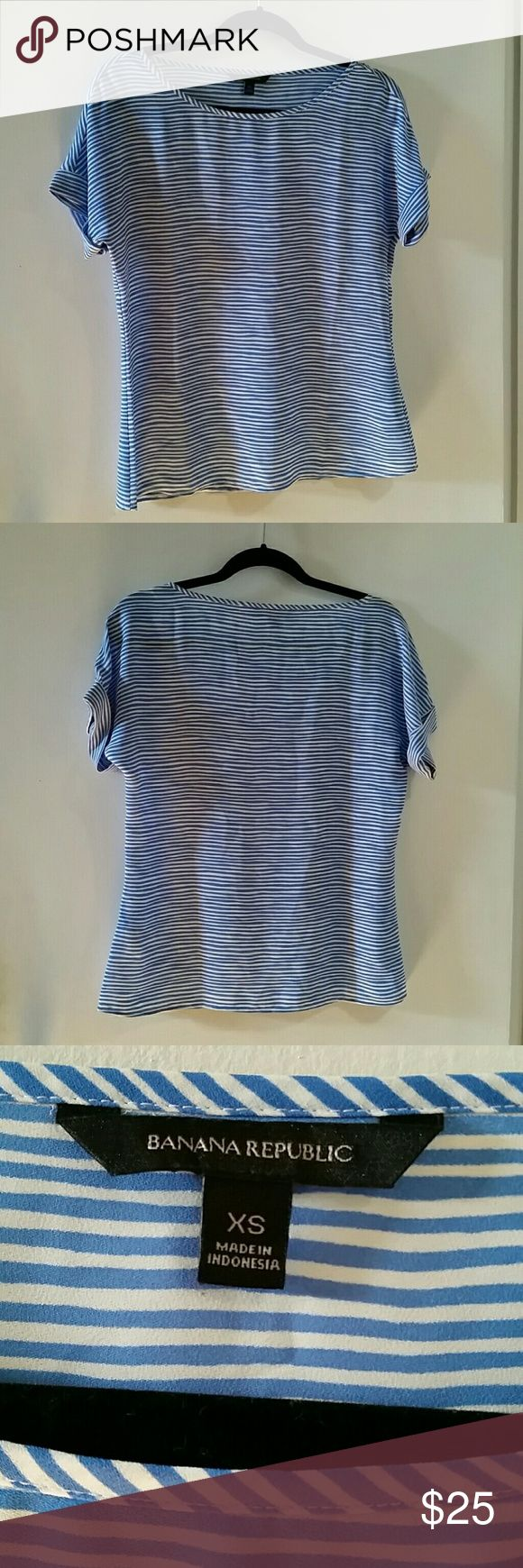 Banana Re public Nautical Blouse Darling blue & white nautical inspired short sleeve blouse by Banana Republic,  size xsmall. In excellent pre-owned condition. No rips, stains, or pulls. Worn twice and hand washed / hung to dry.   Reasonable offers will be considered. No trades or PayPal. Happy Poshing! Banana Republic Tops
