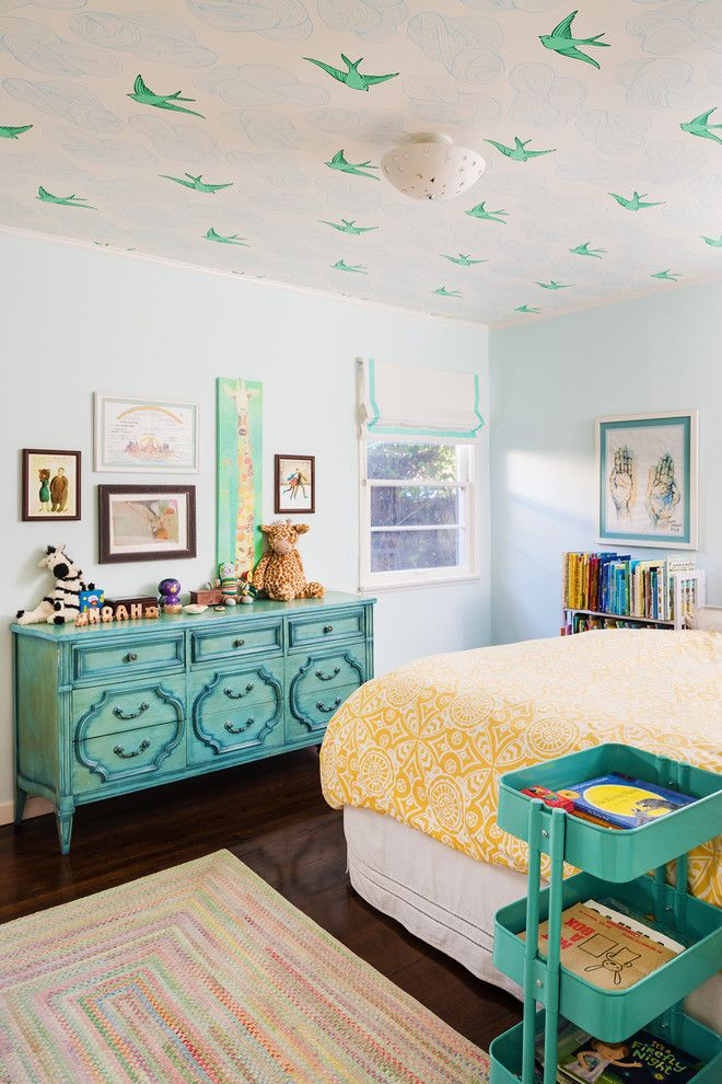Bird wallpaper on ceiling, teal and yellow, colorful rug