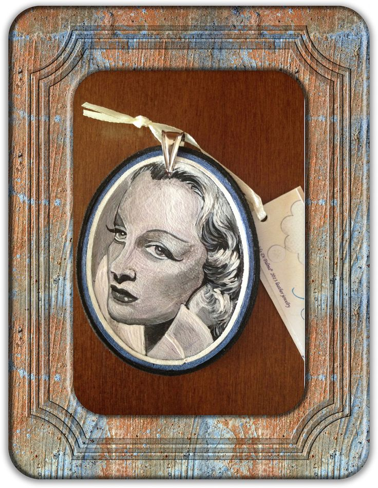 Pendant tribute to Marlene Dietrich, entirely made and hand painted on a double layer of soft leather. Finished with suede strap