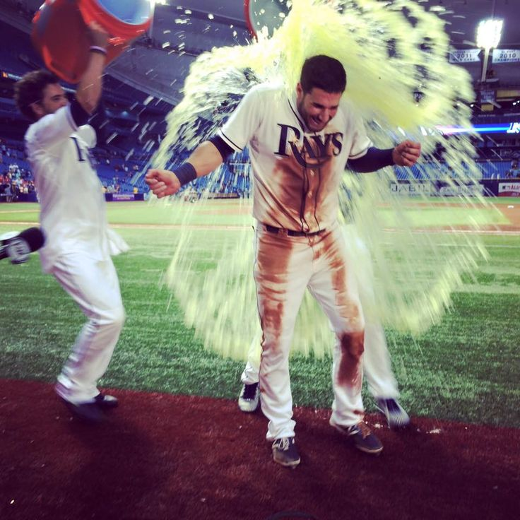 Tampa Bay Rays' Kevin Kiermaier, right, gets doused with water by David DeJesus after the Rays defeated the Washington Nationals 6-1 during a baseball game Monday, June 15, 2015, in St. Petersburg, Fla.