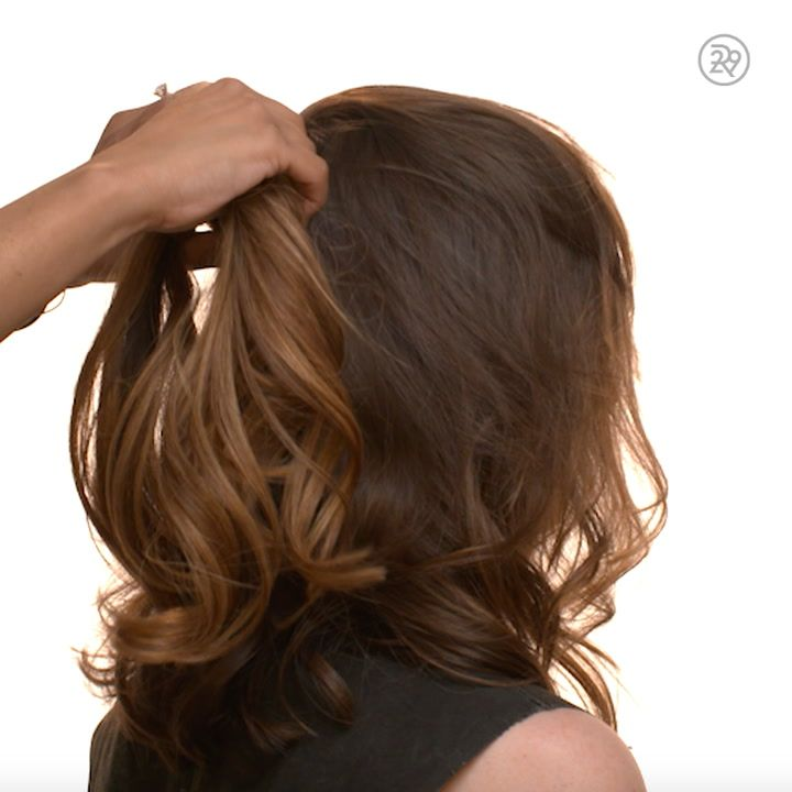 1) Part hair at the center of the back of the hair and attach hair extensions where you plan to secure your ponytail. 2) Brush hair into a ponytail surrounding the extensions, secure with rubber band. 3) Take a small section of hair from the ponytail and wrap it around the rubber band, secure with bobby-pin. 4) Tease with your fingers, a brush, and hairspray for extra volume and texture.