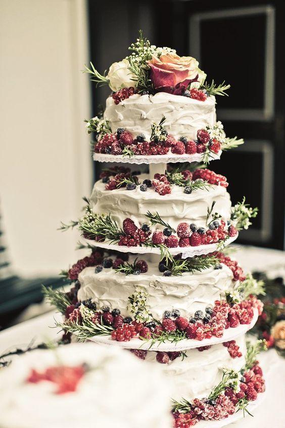 Beautiful wedding cake with wild berries.