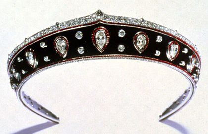 A kokoshnik-shaped gemset platinum-mounted blackened steel tiara, the metal band bordered with calibré-cut rubies, with a band of old-mine diamonds above and rose-cut diamonds below, set with thirteen pear-shaped diamonds within calibré-cut ruby-set frames alternating with pairs of collet-set circular-cut diamonds - workshop: Picq, stamped HP, Paris 1914, height 1 5/8 inches (4.1 cm), diam. 7 1/16 inches (18 cm)   Provenance: Queen Marie of RoumaniaQueens Mary, Jewels Romania, Mary Of Romania Tiaras, Diamonds Tiaras, Steel Tiaras, Crowns Jewels, Blackened Steel, Black Diamonds, Diamonds Kokoshnik