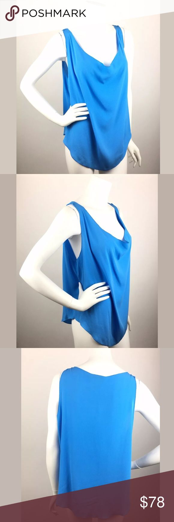 """Alice + Olivia $195 100% Silk Loose Tank Shirt Top Alice + Olivia $195 100% Silk Blue Loose Sleeveless Tank Shirt Oversized Top Condition: Excellent Oversized fit that will fit many sizes; see measurements below to compare to your own  Approximate measurements taken flat: Bust (underarm to underarm): 24"""" Length (top of the shoulder to hem): 28"""" Alice + Olivia Tops Tank Tops"""