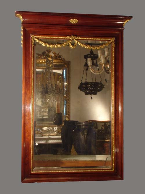 Espejo frances estilo Luis XVI ,marco en madera de caoba y montura de bronces dorados Ca1890