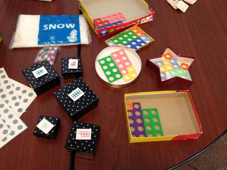 Cheap ideas with Numicon. Try filling different size lids up. Pictures of Numicon on gift boxes to help sorting and matching.