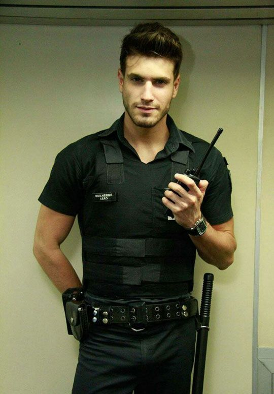 The World's Most Handsome Security Guard.  Im sure Ive done something illegal.  Better frisk me!