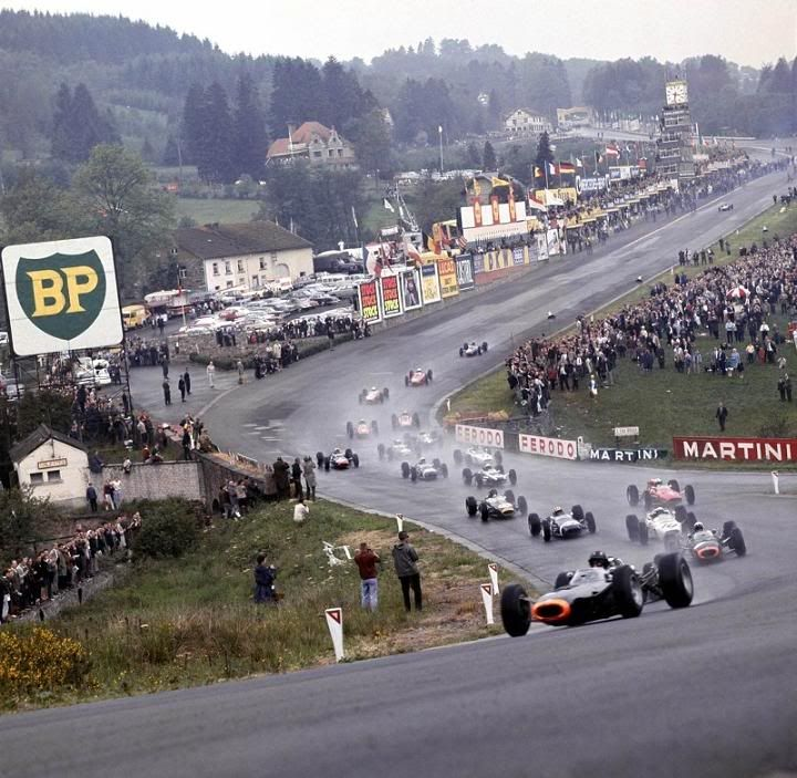 Spa F1 GP, 1965 ♦ The BRMs and Lotus racers lead the start. Jim Clark would famously win this tough, wet race in his Lotus Climax.