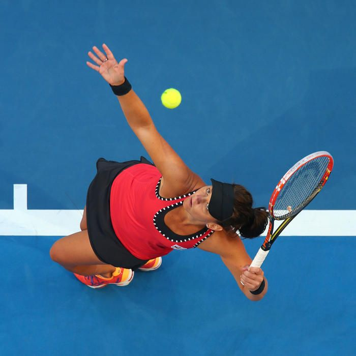 Casey Dellacqua of Australia serves in her singles match against Heather Watson of Great Britain during day six of the 2015 Hopman Cup at Perth Arena on January 9, 2015 in Perth, Australia.