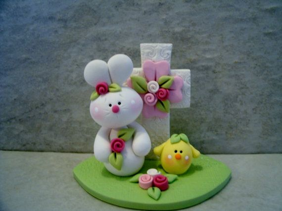 A little white bunny and chick sit in front of an Easter cross.    This is an original design that has been handcrafted from polymer clay.