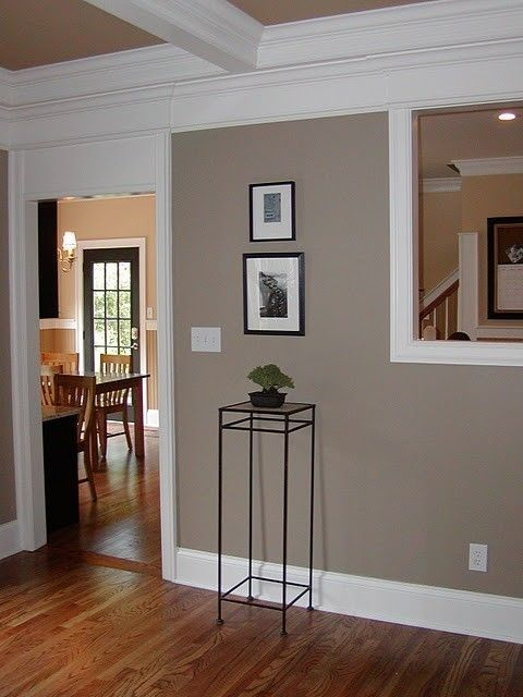 Benjamin Moore Brandon Beige on wall. The light golden color on the walls behind is Benjamin Moore Powell Buff. Powell Buff is also on the ceiling. The darker, golden color below chair rail (on the bead board) is Benjamin Moore Decatur Buff. This is a great color combo if you have dark wood furniture and dark cabinets in your home. by twila