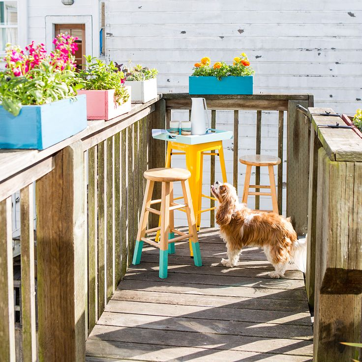 Want to brighten up your porch? Make your own colorful planter boxes with this tutorial. These will work atop a porch railing, hanging off the edge of a balcony or in a window. #partner