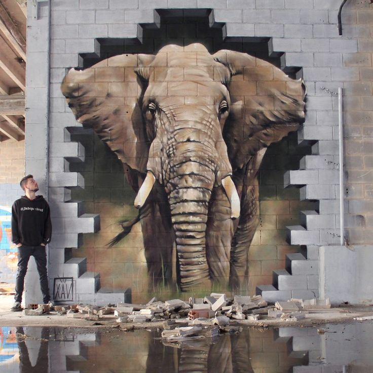 C'est un street art urbain est ancien on peut voir un éléphant qui a casser le mur en brique et qui a l'aire de s'avancer.