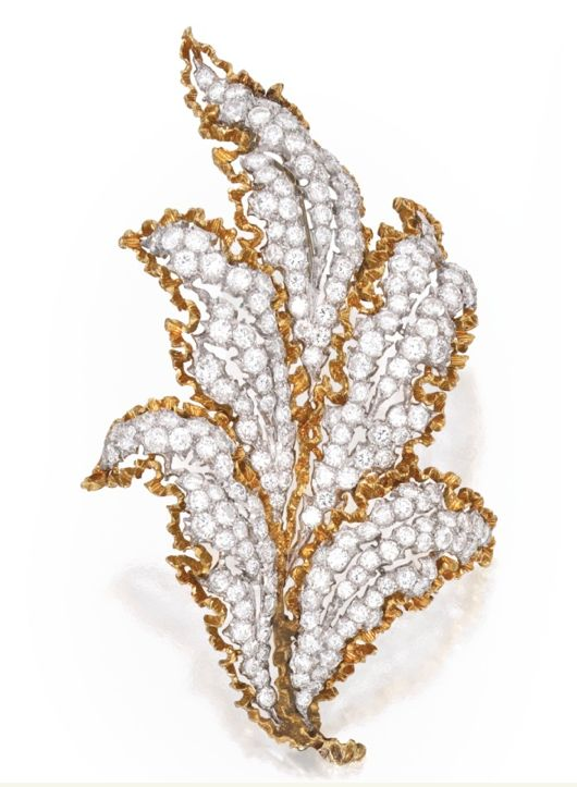 18 KARAT TWO-COLOR GOLD, PLATINUM AND DIAMOND BROOCH, BUCCELLATI The openwork foliate spray set with round diamonds weighing approximately 7.40 carats, signed Buccellati.