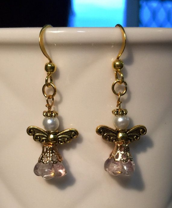 Vintage style angle dangle earrings with glass and pearl beads. In gold, white and pink tones. $9