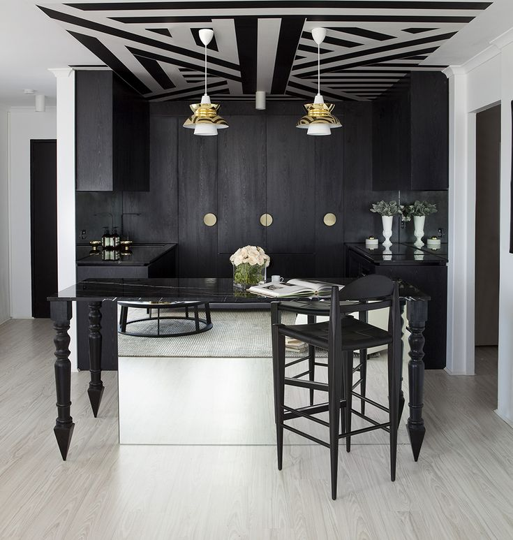 b+w kitchen area - loving that ceiling pattern! This would be so cool as a removable decal.
