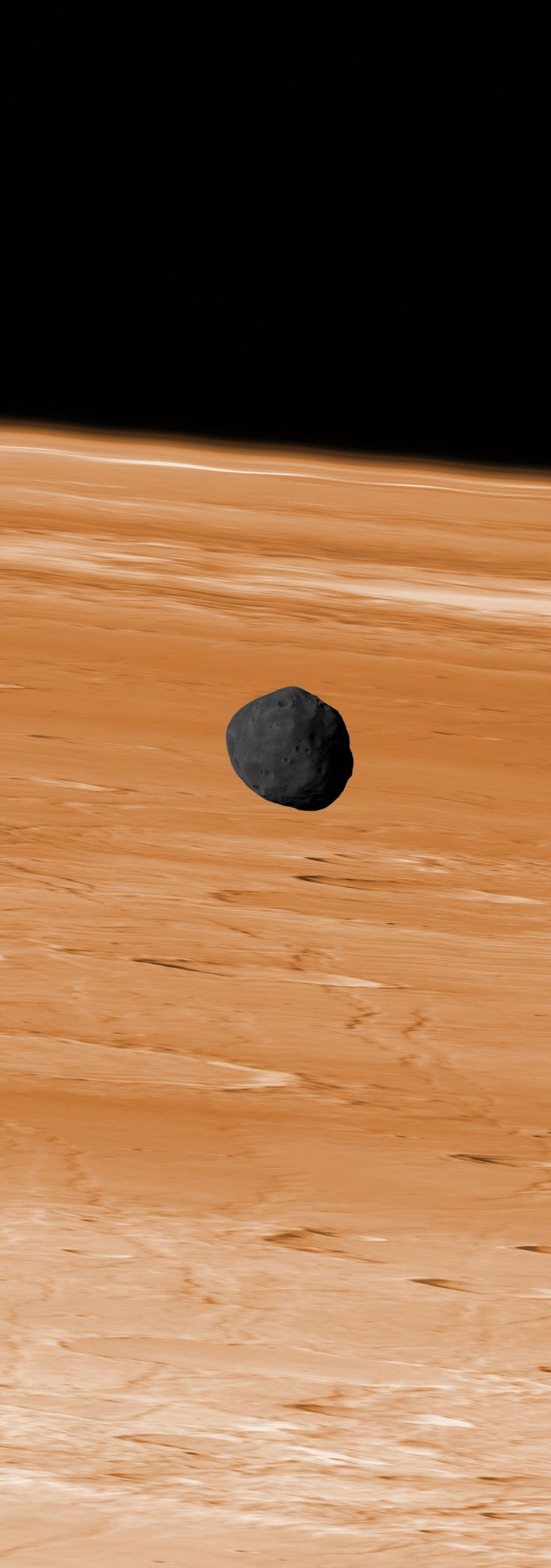 Phobos hangs above Mars (photo by Mars Express probe)