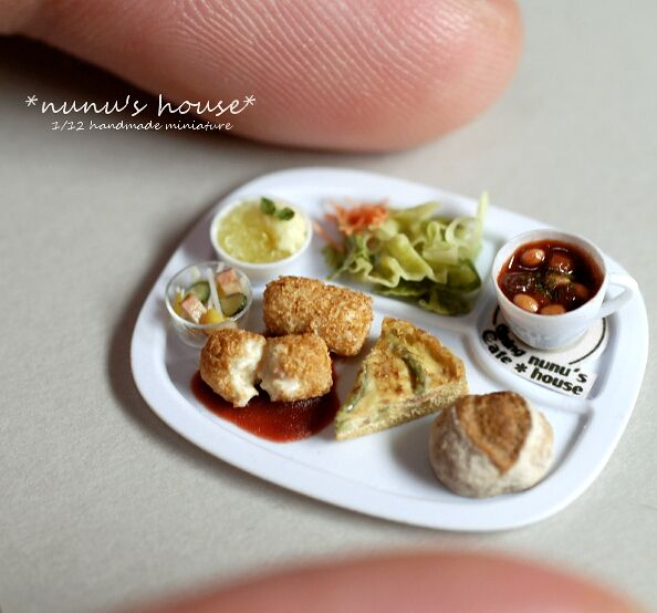 1:12 miniature dinner plate by Tomo Tanaka of Nunu's House, showing relative scale. Look at that detail!