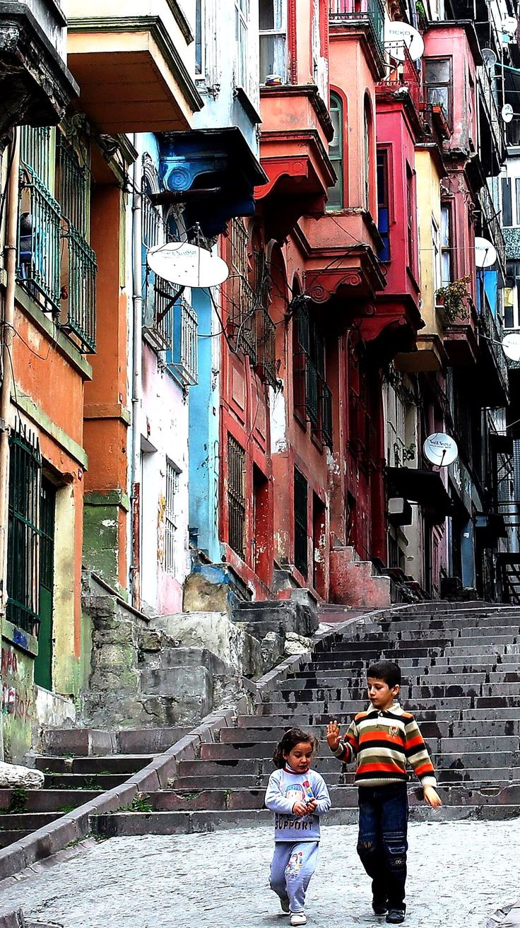 Row of traditional Ottoman style timber houses with protruding oriel windows from the first floor.