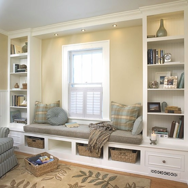 Update your bookshelves... use reset lighting. Two tones of neutral color paint.