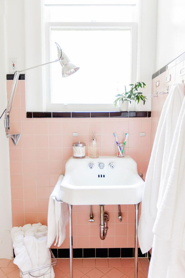 Pink and black bathroom with an original retro sink                                                                                                                                                                                 More